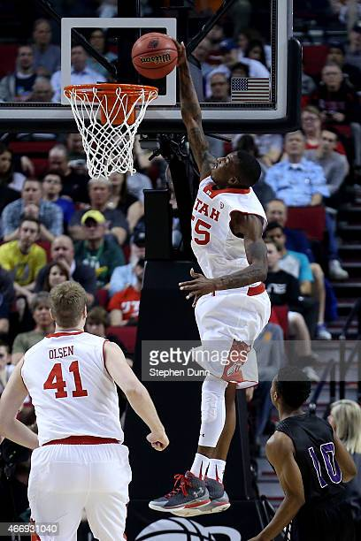 Delon Wright of the Utah Utes goes up for a dunk in the first half against the Stephen F Austin Lumberjacks during the second round of the 2015 NCAA...