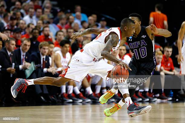 Delon Wright of the Utah Utes handles the ball against Trey Pinkney of the Stephen F Austin Lumberjacks in the second half during the second round of...