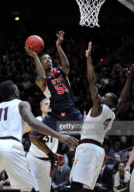 Delon Wright of the Utah Utes puts up two secondhalf points between Savon Goodman and Gerry Blakes of the Arizona State Sun Devils at the Jon M...