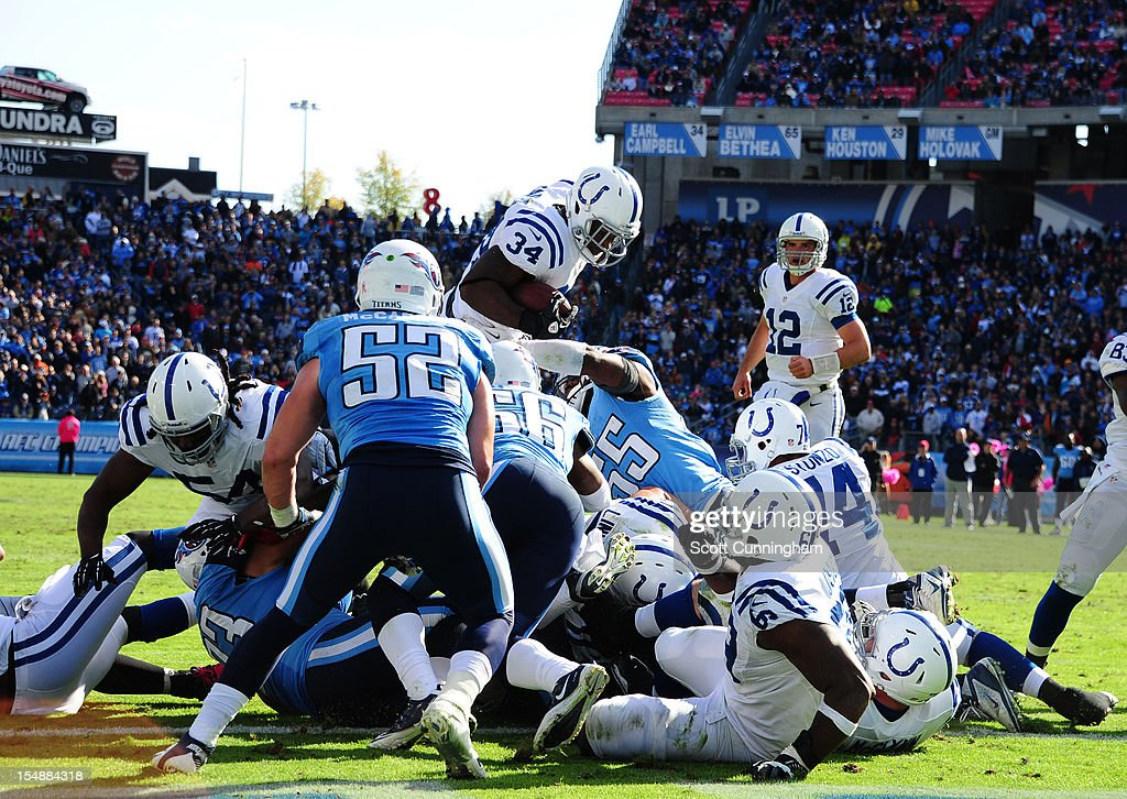Delone Carter #34 of the Indianapolis Colts dives over the top for a touchdown against the Tennessee Titans at LP Field on October 28, 2012 in Nashville, Tennessee.