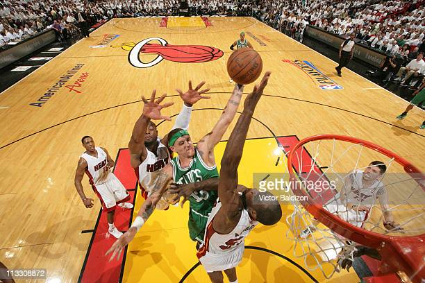 Delonte West of the Boston Celtics dunks against Joel Anthony and Dwyane Wade of the Miami Heat in Game One of the Eastern Conference Semifinals in...