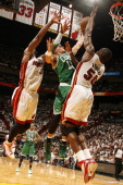 Delonte West of the Boston Celtics shoots against Joel Anthony and Dwyane Wade of the Miami Heat in Game One of the Eastern Conference Semifinals in...