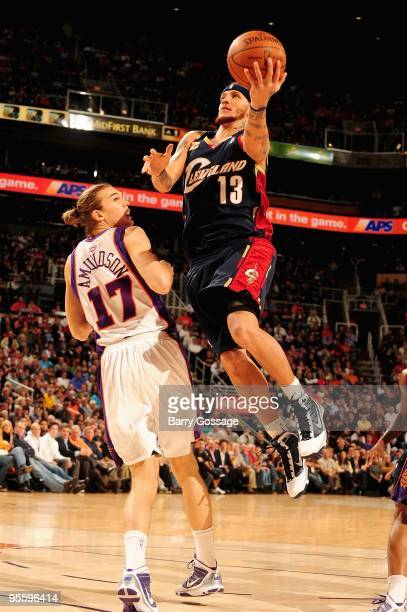 Delonte West of the Cleveland Cavaliers lays the ball up over Louis Amundson of the Phoenix Suns during the game on December 21 2009 at US Airways...