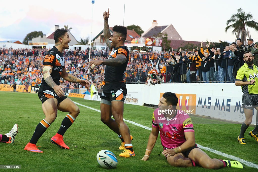 Delouise Hoeter of the Wests Tigers celebrates with Kevin Naiqama of the Wests Tigers after he scored a try during the round 16 NRL match between the Wests Tigers and the Penrith Panthers at Leichhardt Oval on June 28, 2015 in Sydney, Australia.
