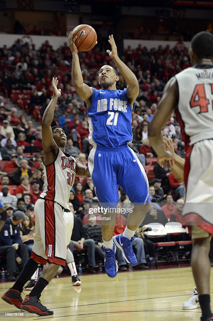 DeLovell Earls #21 of the Air Force Falcons drives to the basket against <a gi-track='captionPersonalityLinkClicked' href=/galleries/search?phrase=Justin+Hawkins&family=editorial&specificpeople=171558 ng-click='$event.stopPropagation()'>Justin Hawkins</a> #31 of the UNLV Rebels at the Thomas & Mack Center on January 12, 2013 in Las Vegas, Nevada. The Rebels won 76-71.