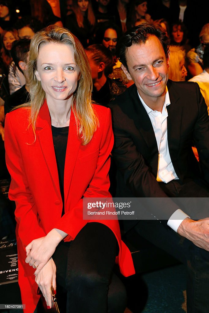 Delphine Arnault and CEO Division Mode for LVMH Group Pierre-Yves Roussel attend Givenchy show as part of the Paris Fashion Week Womenswear Spring/Summer 2014, held at 'la Halle Freyssinet' on September 29, 2013 in Paris, France.