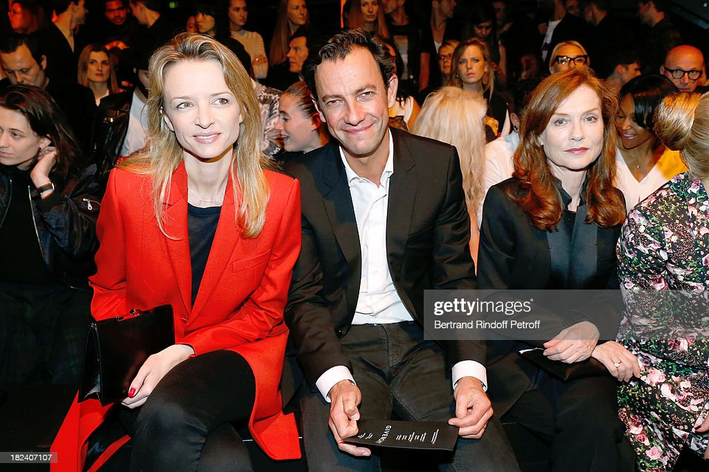 Delphine Arnault, CEO Division Mode for LVMH Group Pierre-Yves Roussel and actress Isabelle Huppert attend Givenchy show as part of the Paris Fashion Week Womenswear Spring/Summer 2014, held at 'la Halle Freyssinet' on September 29, 2013 in Paris, France.