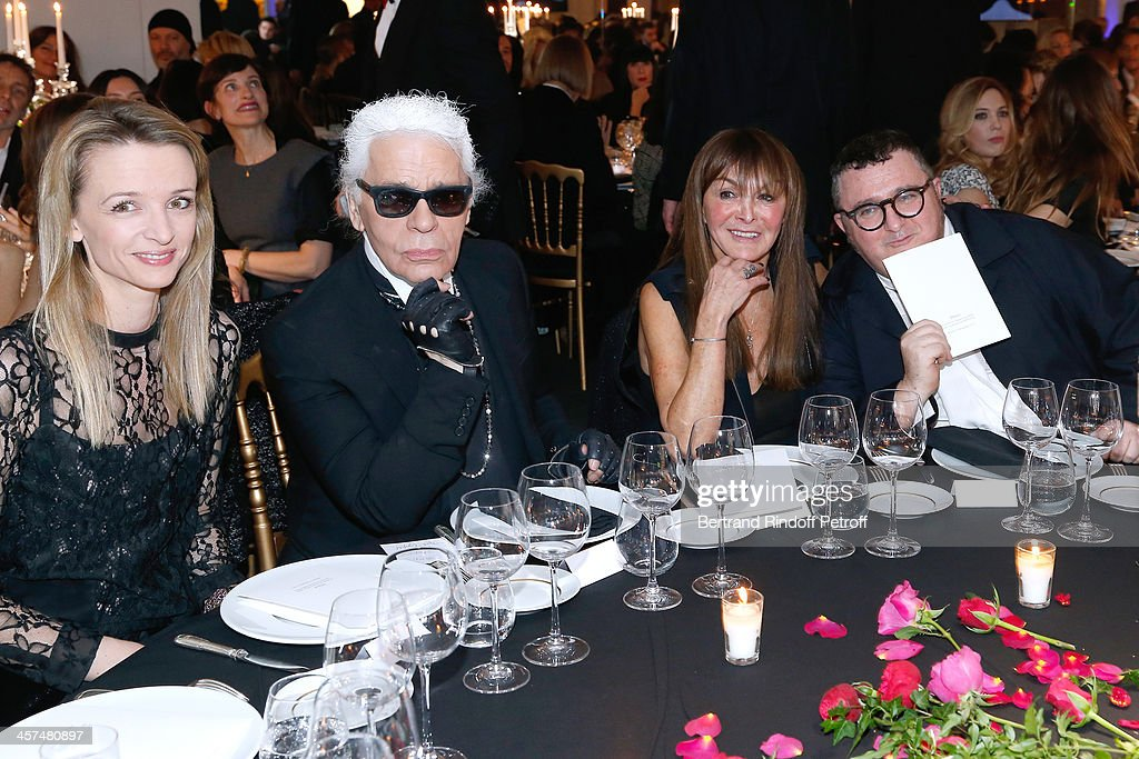 <a gi-track='captionPersonalityLinkClicked' href=/galleries/search?phrase=Delphine+Arnault&family=editorial&specificpeople=577890 ng-click='$event.stopPropagation()'>Delphine Arnault</a>, Fashion Designer <a gi-track='captionPersonalityLinkClicked' href=/galleries/search?phrase=Karl+Lagerfeld+-+Fashion+Designer&family=editorial&specificpeople=4330565 ng-click='$event.stopPropagation()'>Karl Lagerfeld</a>, Organizer of the dinner <a gi-track='captionPersonalityLinkClicked' href=/galleries/search?phrase=Babeth+Djian&family=editorial&specificpeople=5510513 ng-click='$event.stopPropagation()'>Babeth Djian</a> and fashion designer <a gi-track='captionPersonalityLinkClicked' href=/galleries/search?phrase=Alber+Elbaz&family=editorial&specificpeople=783481 ng-click='$event.stopPropagation()'>Alber Elbaz</a> attend the Annual Charity Dinner hosted by the AEM Association Children of the World for Rwanda on December 17, 2013. Held at Espace Pierre Cardin in Paris, France.