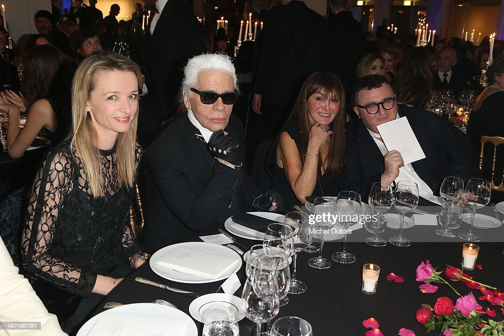 <a gi-track='captionPersonalityLinkClicked' href=/galleries/search?phrase=Delphine+Arnault&family=editorial&specificpeople=577890 ng-click='$event.stopPropagation()'>Delphine Arnault</a>, <a gi-track='captionPersonalityLinkClicked' href=/galleries/search?phrase=Karl+Lagerfeld+-+Fashion+Designer&family=editorial&specificpeople=4330565 ng-click='$event.stopPropagation()'>Karl Lagerfeld</a>, <a gi-track='captionPersonalityLinkClicked' href=/galleries/search?phrase=Babeth+Djian&family=editorial&specificpeople=5510513 ng-click='$event.stopPropagation()'>Babeth Djian</a> and Albert Elbaz attend the Annual Charity Dinner Hosted By The AEM Association Children Of The World For Rwanda on December 17, 2013 in Paris, France.