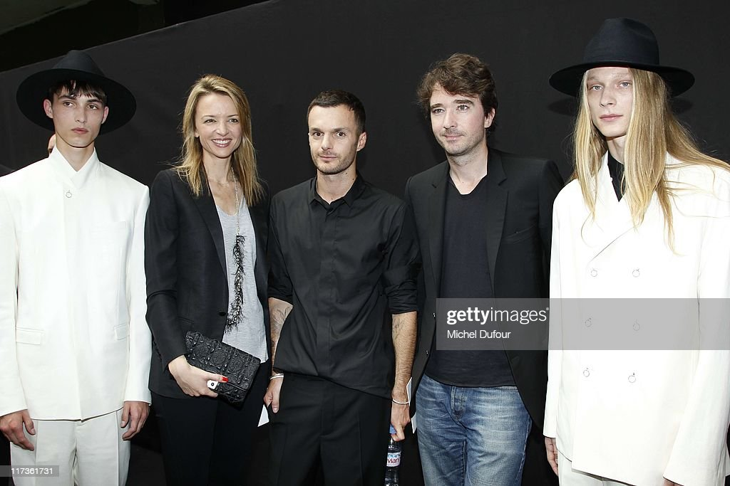 Delphine Arnault, Kris Van Assche, Antoine Arnault and models attend the Dior Homme Menswear Spring/Summer 2012 show as part of Paris Fashion Week at on June 25, 2011 in Paris, France.