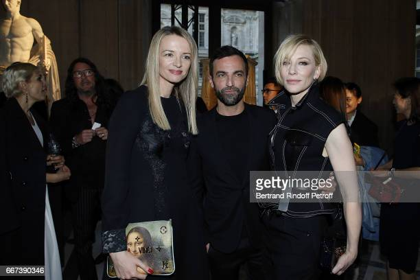 Delphine Arnault Nicolas Ghesquiere and Cate Blanchett attend the 'LVxKOONS' exhibition at Musee du Louvre on April 11 2017 in Paris France