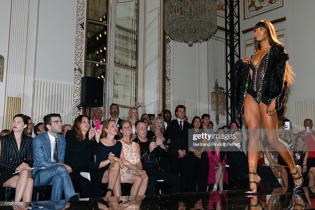 Delphine Chaneac, Zachary Quinto, Guest, Uma Thurman, Jo Levin and David Furnish watching model Naomi Campbell on the catwalk of the Versace show as part of Paris Fashion Week Haute-Couture Fall/Winter 2013-2014 at on June 30, 2013 in Paris, France.