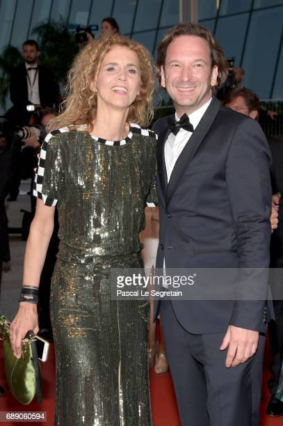 Delphine De Vigan and Francois Busnel leave the 'Based On A True Story' screening during the 70th annual Cannes Film Festival at Palais des Festivals...