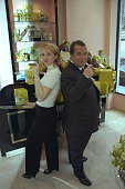Delphine Jacobsen and PaulLoup Sulitzer try Godiva's chocolate cigar