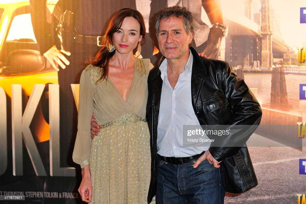 Delphine Rollin and Laurent Olmedo attend the 'Taxi Brooklyn' Paris premiere at Cinema Gaumont Marignan on March 10, 2014 in Paris, France.