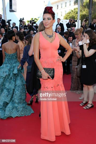 Delphine Wespiser attends the 'Ismael's Ghosts ' screening and Opening Gala during the 70th annual Cannes Film Festival at Palais des Festivals on...