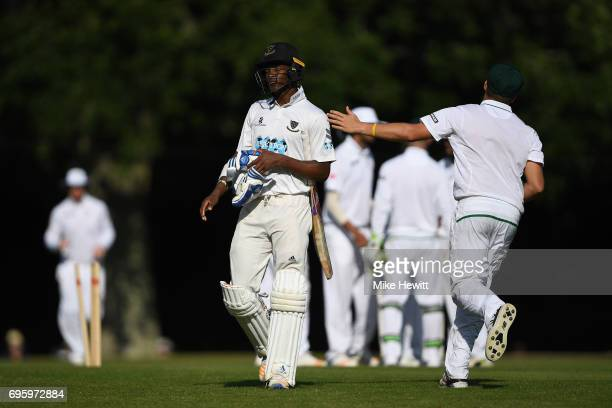 Delray Rawlins of Sussex is consoled by a South African fielder after being bowled for 96 during a Tour Match between Sussex and South Africa A at...