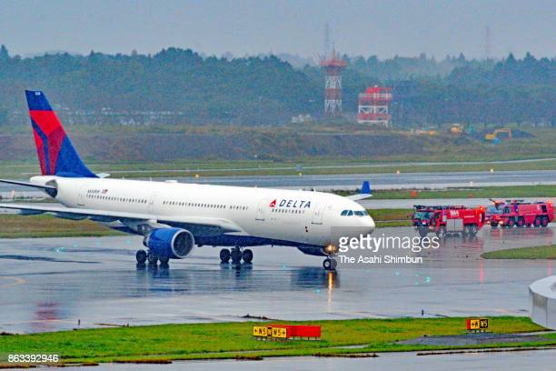 Delta Air Lines flight 38 is seen after an emergency landing at Narita International Airport on October 19 2017 in Narita Chiba Japan The air line...