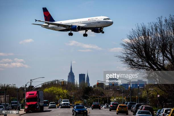 A Delta Air Lines Inc plane prepares for landing at LaGuardia Airport in New York US on Tuesday April 18 2017 An additional section of land could be...