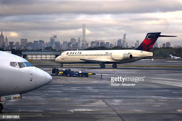 A Delta Air Lines passenger jet taxis on the tarmac at LaGuardia Airport in the New York City borough of Queens on September 7 2016
