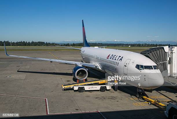 Delta Airlines Airbus jet unloads baggage at a Terminal A gate at SeattleTacoma International Airport on May 2 in Seattle Washington Seattle located...