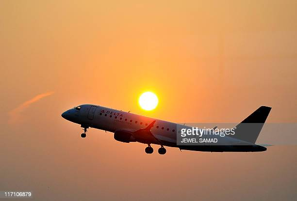 A Delta airline's aircraft takes off from the Ronald Regan National airport as the sun rises in Washington DC on June 9 2011 The Atlantabased carrier...