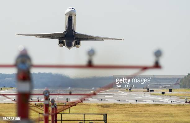 A Delta Airlines airplane takes off from Ronald Reagan Washington National Airport in Arlington Virginia August 15 2016 / AFP / SAUL LOEB