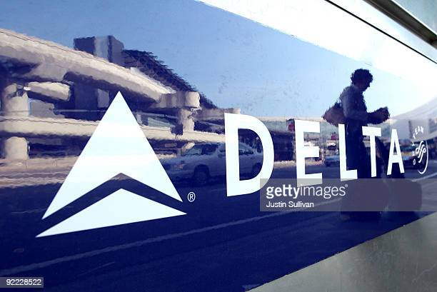 Delta airlines customer is reflected in a sign on a baggage check in kiosk October 22 2009 at San Francisco International Airport in San Francisco...