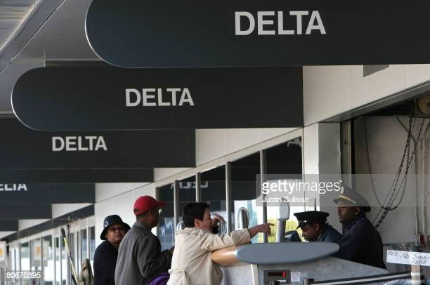 Delta Airlines customers check bags with a sky cap at the Delta ticket counter April 14 2008 at San Francisco International Airport in San Francisco...