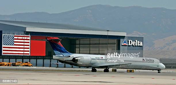 Delta Airlines jet passes the Delta hanger at the Salt Lake International Airport August 12 2005 in Salt Lake City Utah The resent increase in fuel...