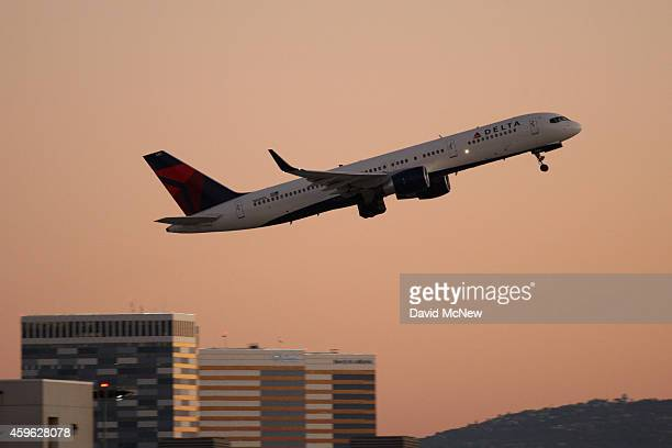 Delta Airlines jet takes off at LAX as people travel to Thanksgiving holiday destinations on November 26 2014 in Los Angeles California Travel...