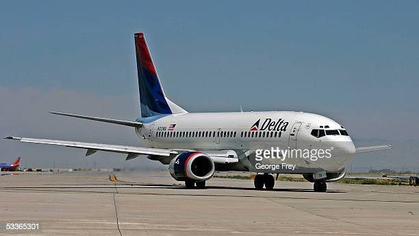 Delta Airlines jet taxies for takeoff at the Salt Lake International Airport August 12 2005 in Salt Lake City Utah The resent increase in fuel prices...