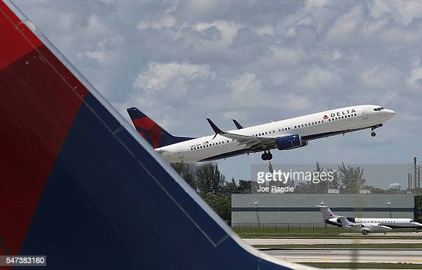 Delta airlines plane is seen as it takes off at the Fort LauderdaleHollywood International Airport on July 14 2016 in Fort Lauderdale Florida Delta...