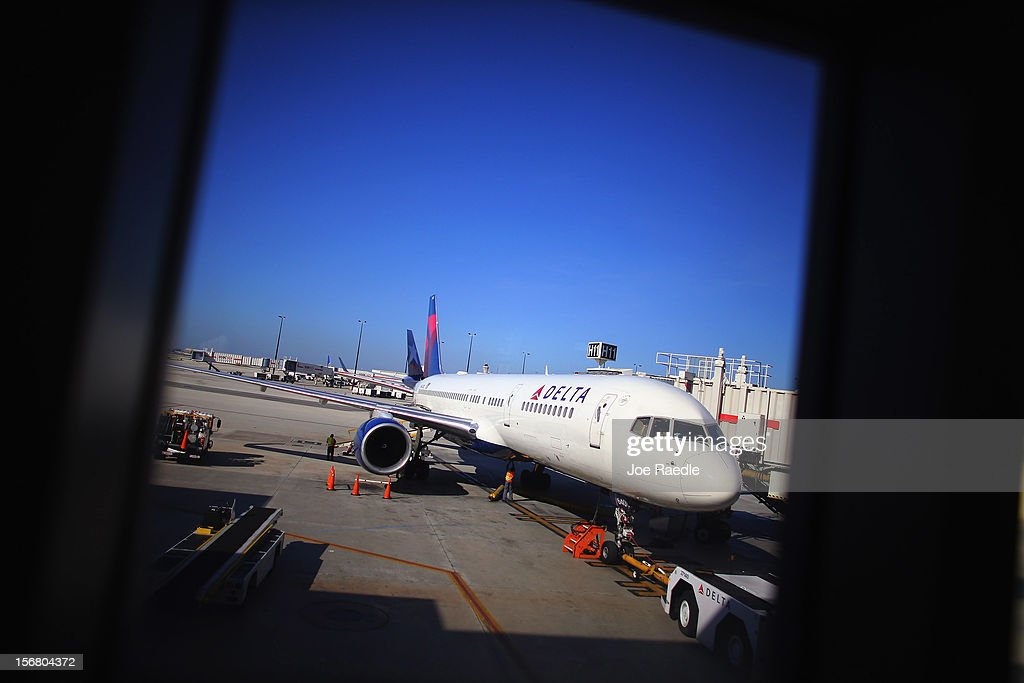 A Delta airlines plane sits at the gate in LaGuardia Airport on the day before Thanksgiving November 21, 2012 in New York, United States. The day before the Thanksgiving holiday is one of the busiest travel days of the year.
