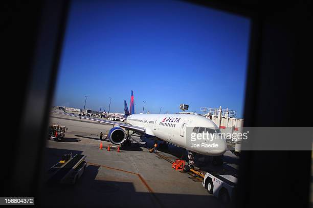 Delta airlines plane sits at the gate in LaGuardia Airport on the day before Thanksgiving November 21 2012 in New York United States The day before...