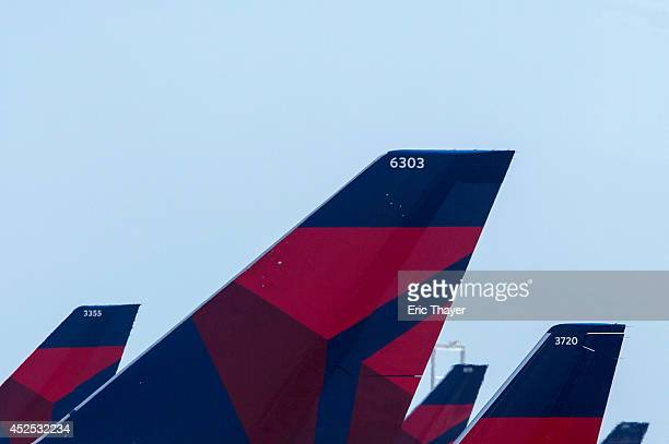 Delta Airlines planes sit at Terminal 4 at John F Kennedy Airport July 22 2014 in New York City The Federal Aviation Administration has halted all...