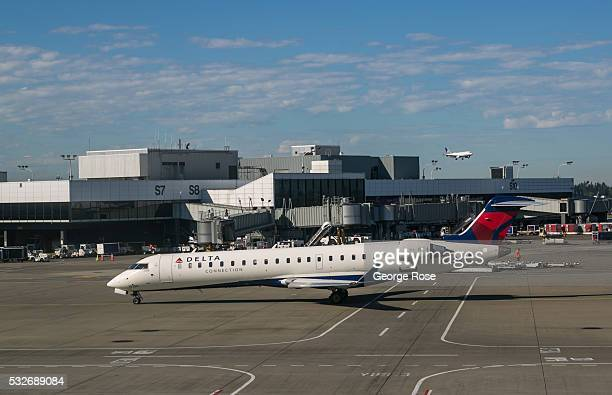 Delta Airlines regional jet prepares to pull into a Terminal A gate at SeattleTacoma International Airport on May 2 in Seattle Washington Seattle...