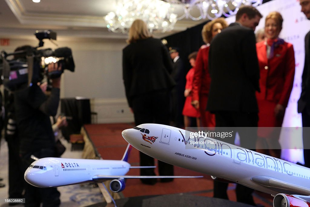 Delta and Virgin Atlantic model planes are viewed at a news conference where it was announced that Delta Air Lines is buying a 49 percent stake in Richard Branson's Virgin Atlantic Airways Ltd. from Singapore Airlines for $360 million on December 11, 2012 in New York City. The airlines will begin a joint venture on 31 roundtrip daily flights between North America and Heathrow Airport, one of the world's busiest hubs.