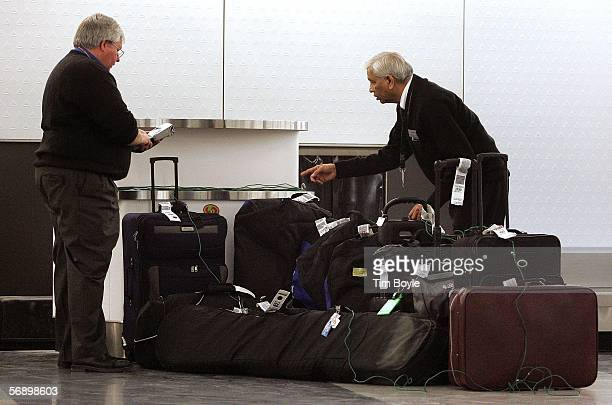 Delta customer service agent and contractor Narendra Patel check yettobeclaimed luggage at the Delta luggage claim area February 21 2006 at O'Hare...