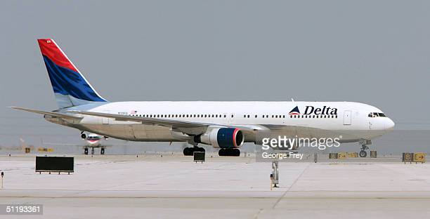 Delta flight taxies after landing at the Salt Lake City International Airport August 19 2004 in Salt Lake City Utah Delta is trying to restructure...