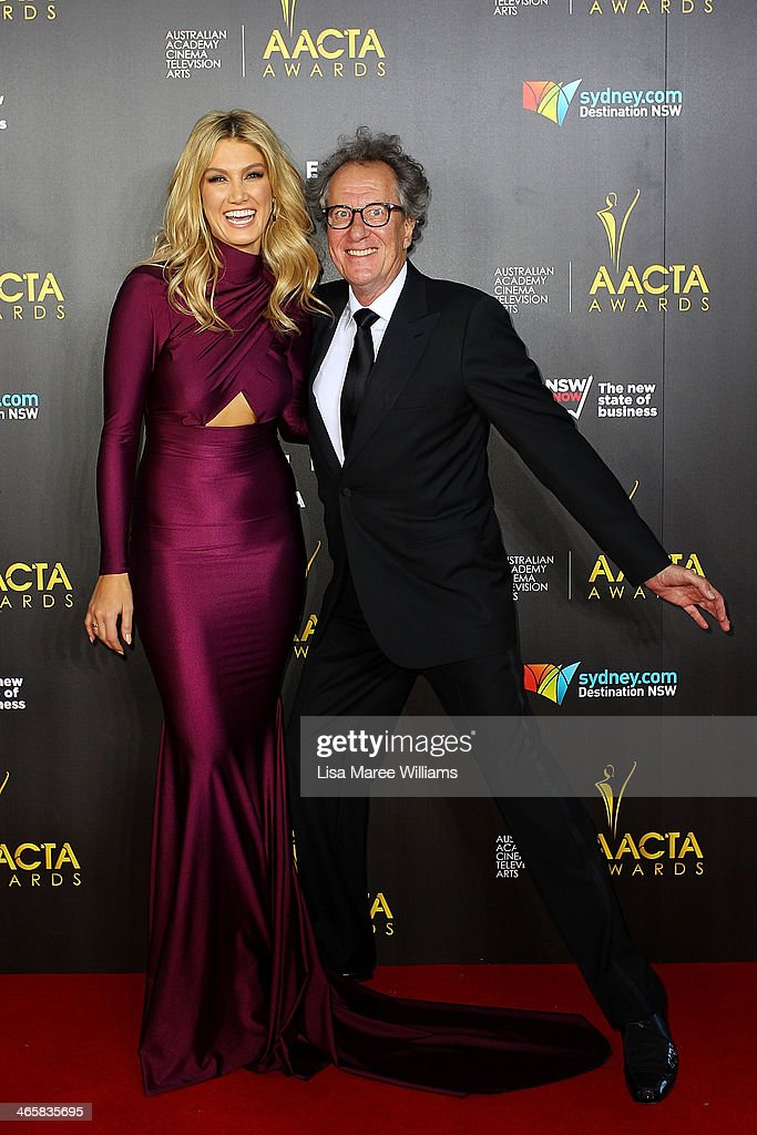 <a gi-track='captionPersonalityLinkClicked' href=/galleries/search?phrase=Delta+Goodrem&family=editorial&specificpeople=201895 ng-click='$event.stopPropagation()'>Delta Goodrem</a> and <a gi-track='captionPersonalityLinkClicked' href=/galleries/search?phrase=Geoffrey+Rush&family=editorial&specificpeople=201849 ng-click='$event.stopPropagation()'>Geoffrey Rush</a> arrive at the 3rd Annual AACTA Awards Ceremony at The Star on January 30, 2014 in Sydney, Australia.
