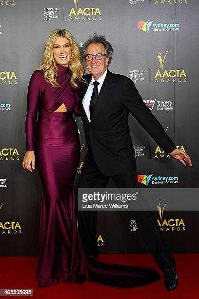 Delta Goodrem and Geoffrey Rush arrive at the 3rd Annual AACTA Awards Ceremony at The Star on January 30 2014 in Sydney Australia