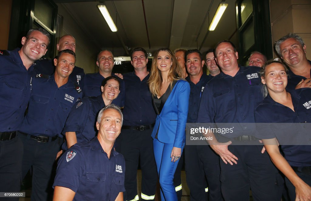 Delta Goodrem poses alongside firemen at the launch of Delta by Delta Goodrem on April 20, 2017 in Sydney, Australia.