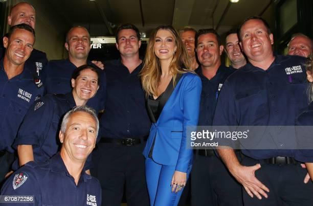 Delta Goodrem poses alongside firemen at the launch of Delta by Delta Goodrem on April 20 2017 in Sydney Australia