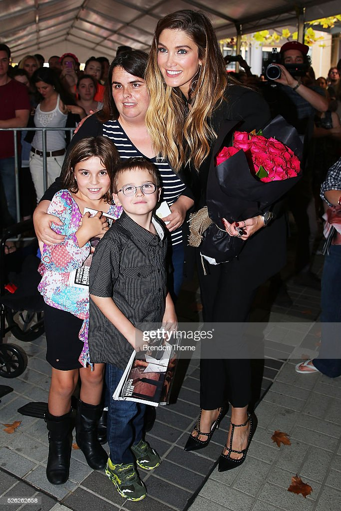 <a gi-track='captionPersonalityLinkClicked' href=/galleries/search?phrase=Delta+Goodrem&family=editorial&specificpeople=201895 ng-click='$event.stopPropagation()'>Delta Goodrem</a> signs autographs and poses for photos with fan following the performance of her new single 'Dear Life' at Westfield Hornsby on April 30, 2016 in Sydney, Australia.