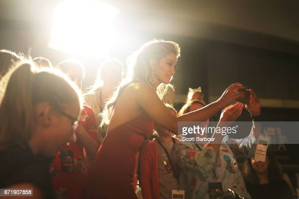 Delta Goodrem takes a selfie with a fan in the crowd as she arrives at the 59th Annual Logie Awards at Crown Palladium on April 23 2017 in Melbourne...