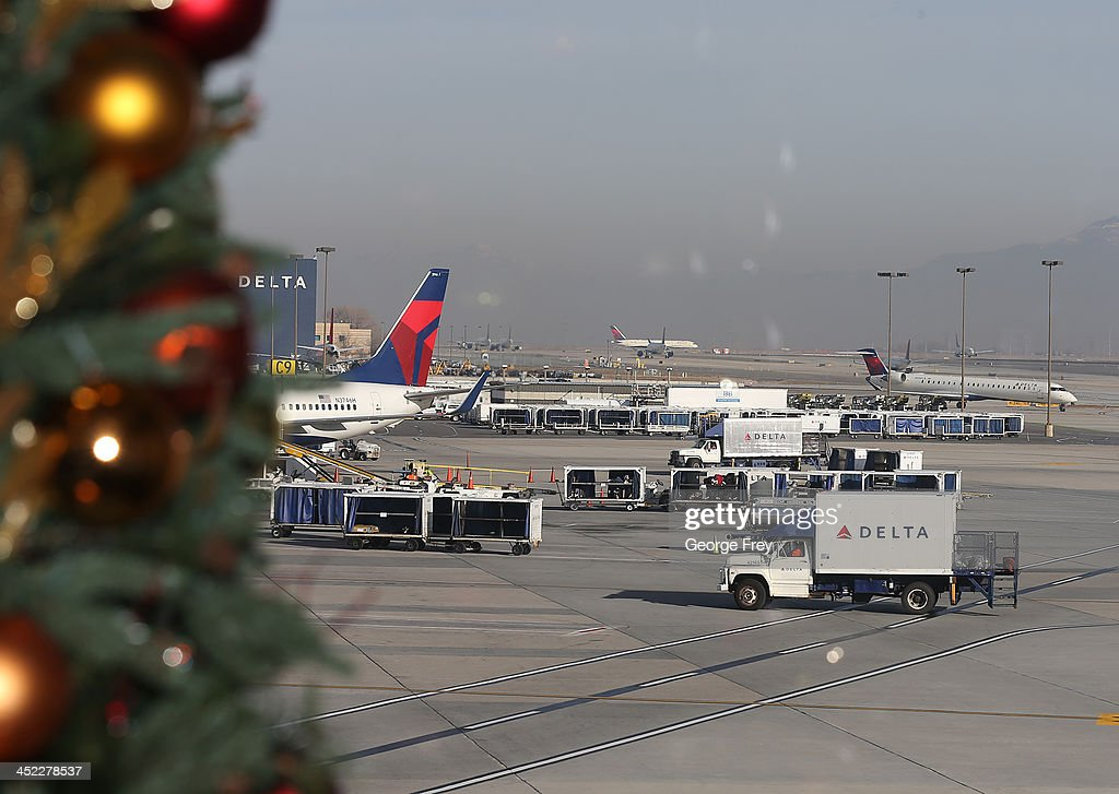 Delta planes stack up for take-off and are proceed through the Salt Lake City international Airport on November 27, 2013 in Salt Lake City, Utah. A wintry storm system that is covering much of the nation is threatening to wreak havoc on holiday travel .
