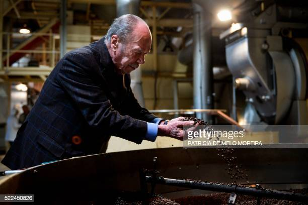 Delta's boss Rui Nabeiro holds grains of coffee at his coffee factory in Campo Maior on March 22 2016 Rui Nabeiro 85 year old philanthropist built...