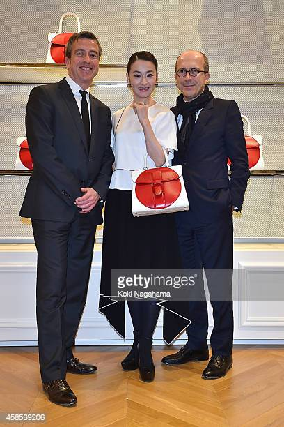 Delvaux CEO Marco and Actress Rei Dan and DELVAUX Chairman JeanMarc attend the Delvaux Red Moon Party at Delvaux Omotesando on November 7 2014 in...