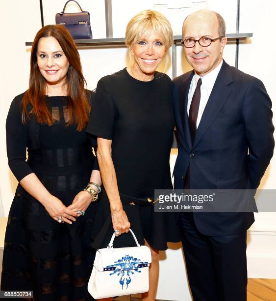 Delvaux President Jean Marc Loubier his wife Hedieh Loubier and French First Lady Brigitte Macron are pictured during the visit of the partners of...